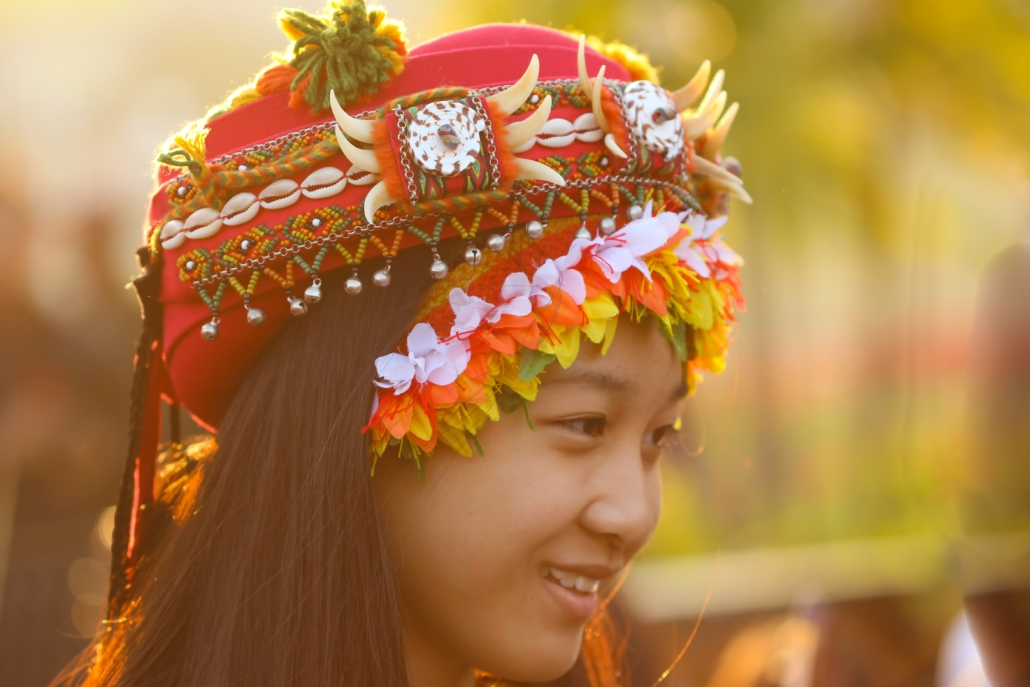 Diaspora heritage as an Asian young lady wearing her traditional costume