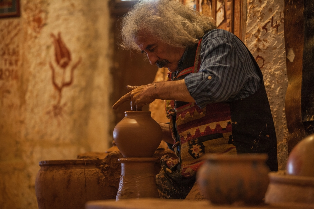 man working with clay as a demonstration of his cultural Heritage in the diaspora