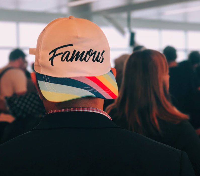Guy with cap saying Famous