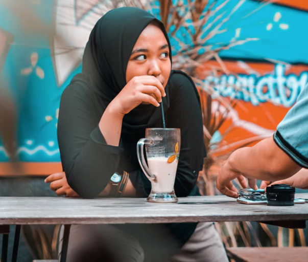 Muslim girl with coffee