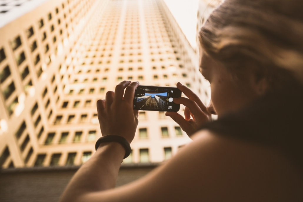 woman taking pictures with her smartphone