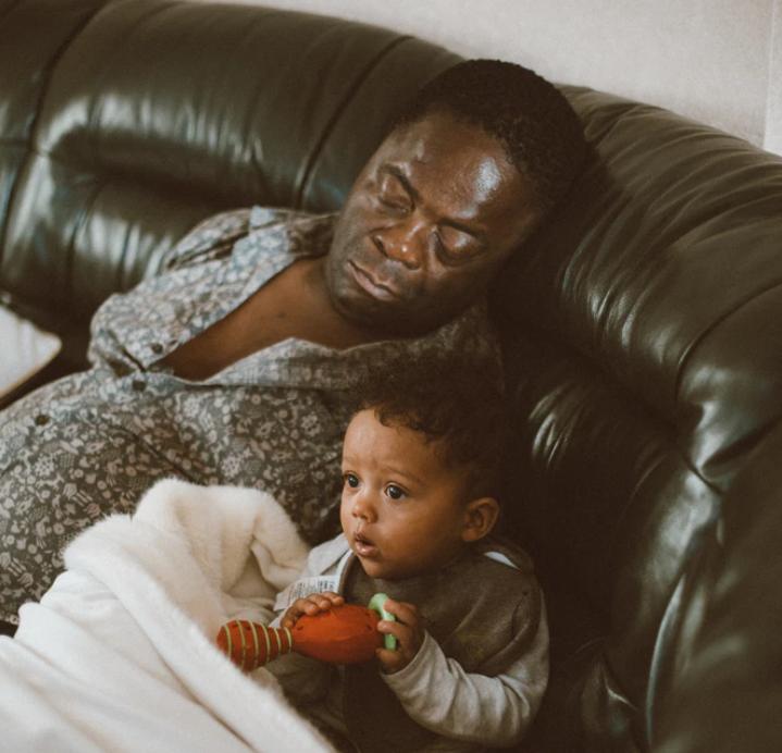 man sleeping next to his Cuban son