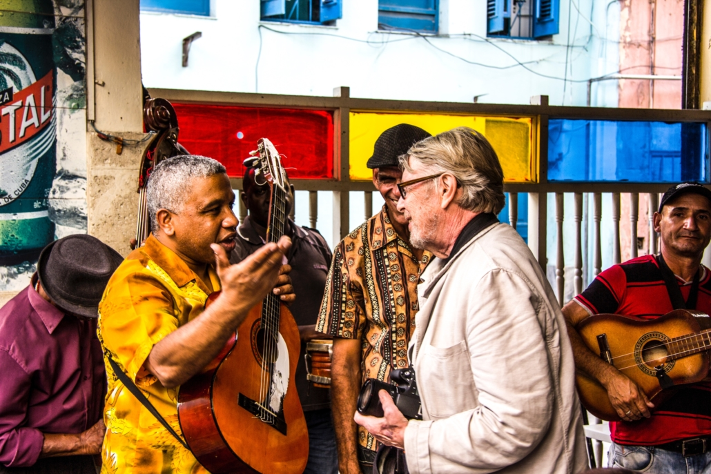 Cuban musician talking to a foreigner