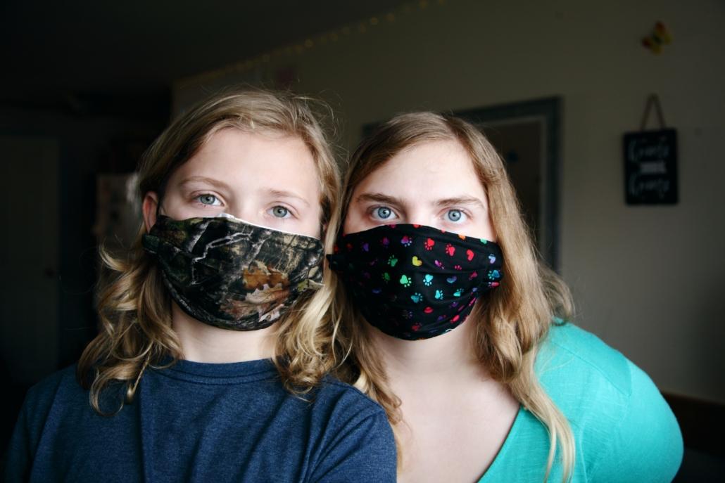 mother and child wearing coronavirus masks