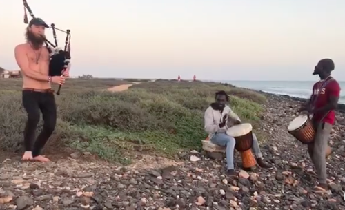 bagpipe artist playing with locals in Cape Verde