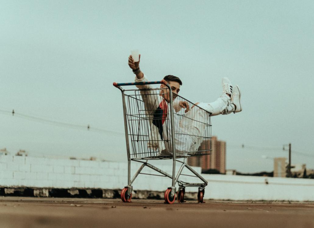 man in a shopping cart